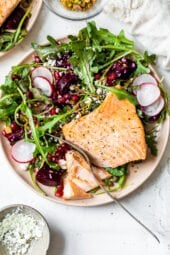 This beautiful heart-healthy salad makes salmon filets a focal point nestled atop the colorful salad with many textures.