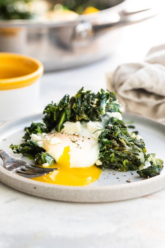 egg with runny yolk and spinach.